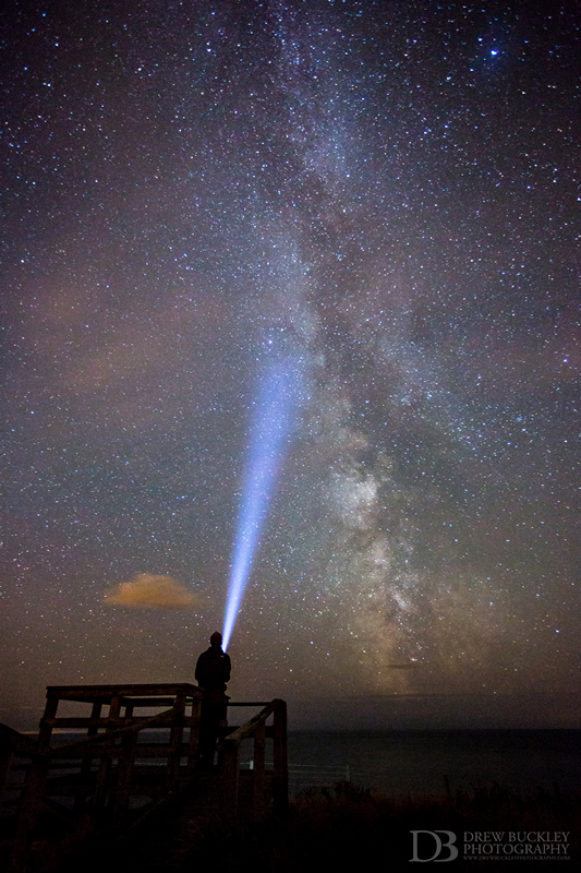 Photographer-Drew-Buckley-shines-a-torch-into-as-the-Milky-Way-fills-the-southern-skies-over-the-Pembrokeshire-Coast-August-13th-2013.jpg